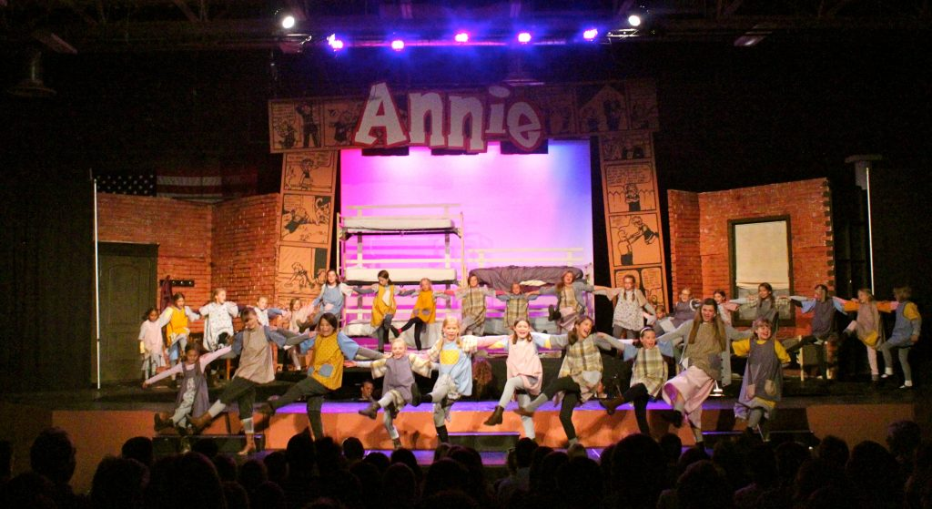 "The Orphans in the Annie 2014 productions dancing during the song ""Fully Dressed."""